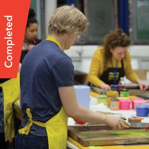 Young adult carer doing screen printing