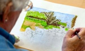 A picture of a person painting a landscape