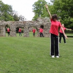 JumpstART students performing around ruins