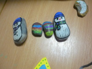 Pebbles with snowmen painted on them