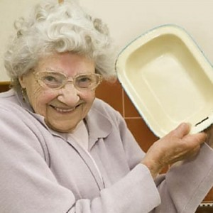 Woman holding a metal pie dish
