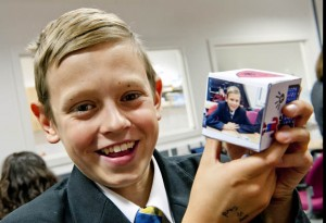 Pupil with picture of themself on a decorated paper cube