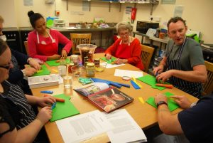 Around the Table carer group learning knife skills