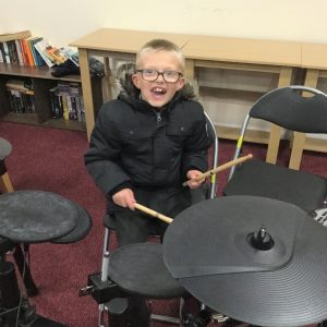 Young lad playing drums