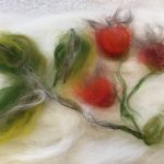 Felt picture of rose hips