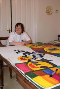 Ruth with her large coloured pen portraits